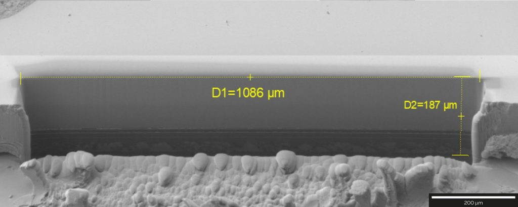 1086 mm-wide cross-section through part of an OLED display, SE detector at 2 kV