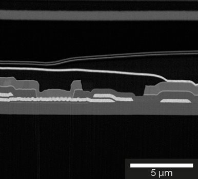 Detailed image of the cross-section of the OLED display showing Al contacts and SiO2/SiNx layer structure imaged with the Mid-Angle BSE detector at 2 keV.