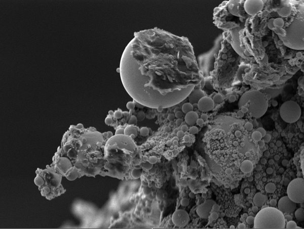 Tin on carbon:A tin-on-carbon test specimen, viewed at 2,930x magnification